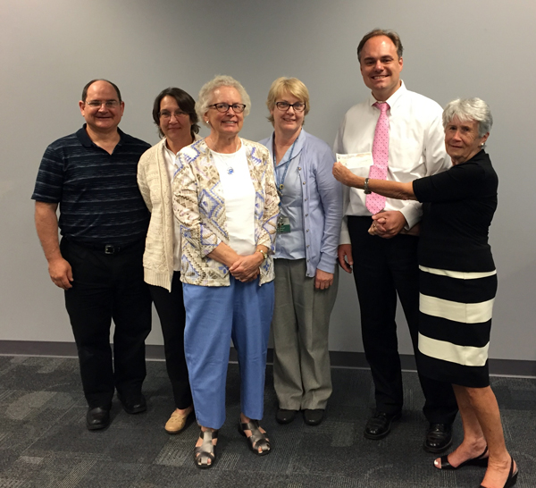L to R: Jim Puzo, Friends; Martina Kominiarek, CEO, Bucks County Free Library; Nancy Masulis, Friends; Pat Hartman, Levittown Library Branch Manager; ?, Friends; Roberta Foerst, President, Bucks County Free Library Board